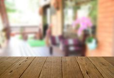 Blurred image wood table and woodden chair and table setting on Stock Image