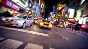 Blurred image of yellow taxi cab in New York Royalty Free Stock Photography