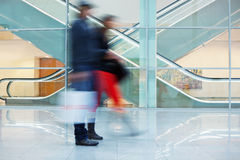 Blurred Image of Young Couple in Office Building. Motion blurred image of young people Stock Photo