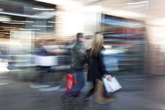 Blurred image of young people in shopping center. Intentional blurred image of young people in shopping center Royalty Free Stock Photo