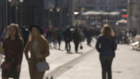 Blurred intentionally, women are walking along the sunny streets of the city. A beautiful sunny day. Blurred intentionally, women are walking along the sunny stock video