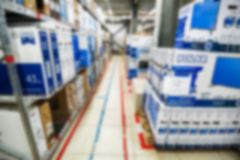 Blurred interior of hardware shop storage. Abstract blurred interior of house appliances store warehouse Royalty Free Stock Image