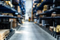 Blurred interior of modern spare parts warehouse stock photos