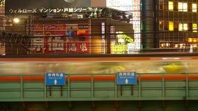 Blurred Japan Rail Train Passes over Bridge in Central Tokyo Japan. Japan Rail Train Passes By stock video footage