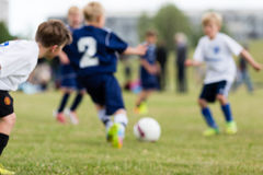 Blurred kids playing soccer Royalty Free Stock Images