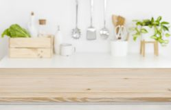 Free Blurred Kitchen Workplace With Empty Wooden Table Top In Front Royalty Free Stock Images - 139438909