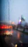 Blurred light of cars seen through wet windshield with some raindrops. Blurred light of cars seen through a wet windshield with some raindrops Stock Photography