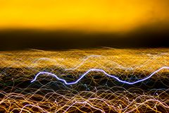 Blurred Light painting, Abstract of lighting equipment. Abstract yellow neon painting. Bokeh glitter round shapes . Abstract light. Abstract lights at motion stock photography