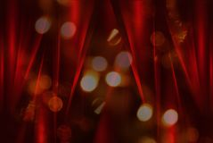 Blurred light and red silk curtains Royalty Free Stock Images