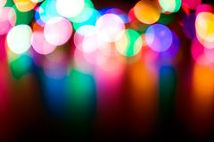 Blurred lights. Defocused colorful flashing lights on a black background Royalty Free Stock Photos