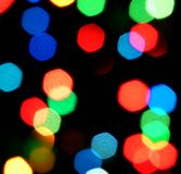 Blurred lights. Christmas garland shot absolutely defocused on a black background Royalty Free Stock Photos