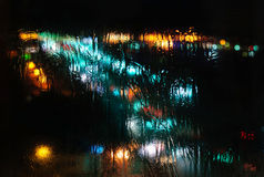 Blurred lights abstract background. Blurred defocused lights of night city through frozen window, abstract background Stock Images