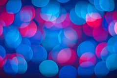 Blurred lights background. Vivid abstract background - defocused blue and red lights Royalty Free Stock Photography
