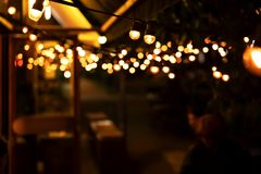 Blurred lights of cafe in the evening stock images