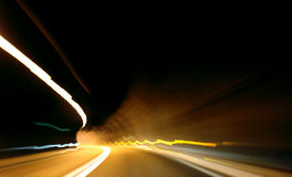 Blurred lights captured. Taken while driving at night in the tunnel Stock Images