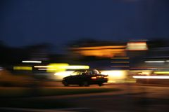 Blurred lights and car. At night Royalty Free Stock Photo