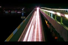 Blurred lights of cars on the bridge Stock Photos