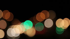 Blurred lights in different colors with black background with panning. stock video