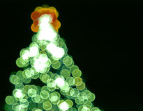 Blurred lights in form of Christmas tree Royalty Free Stock Photo