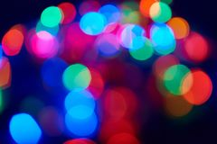 Blurred lights garland. On a dark background Royalty Free Stock Images