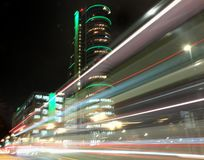Blurred lights left by moving traffic at night in bridgewate place leeds stock photos