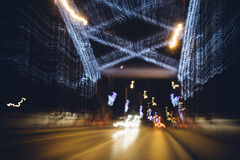 Blurred lights of night decorative lighting on bridge Stock Photography