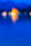 Blurred lights reflecting water. Royalty Free Stock Image