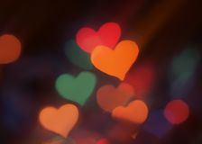 Blurred lights in a shape of heart Stock Photos
