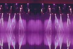 Blurred lights on stage with purple curtains royalty free stock photography