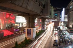 Blurred lights under the bridge. City road and BTS Skytrain Track in Bangkok, Thailand Stock Photography
