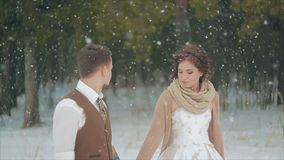 Blurred loving couple walking in winter christmas snowfall stock footage