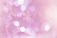 Blurred male female symbols on blurred pink bokeh background. Soft feeling royalty free illustration