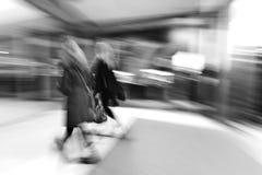 People rushing through corridor, zoom effect stock image