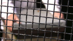 Blurred man behind the grid stock footage