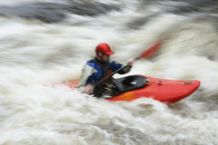 Blurred Man kayaking in river stock photography