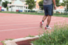 Blurred man running track for in the stadium. Stock Image