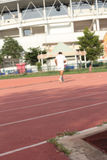 Blurred man running track for in the stadium. Stock Photos