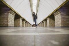 Blurred man on subway platform. In a big city Stock Photo