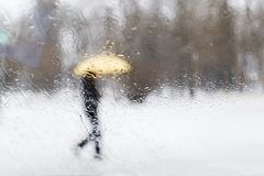 Blurred man with umbrella at rainy day Royalty Free Stock Images