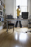 Blurred Man Using Phone At Home Office Stock Photos