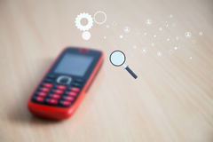 Blurred mobile phone on wooden surface. Stock Image