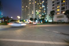Blurred modern urban city at night with street traffic Stock Photo