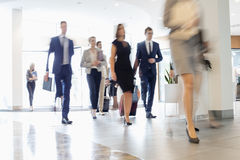 Blurred motion of business people walking at convention center.  stock images