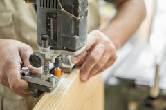 Blurred motion of carpenter working, preparing door for hinges Royalty Free Stock Photography