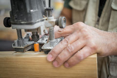 Blurred motion of carpenter working, preparing door for hinges Stock Photography