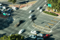 Blurred motion of cars on road intersection Royalty Free Stock Photography