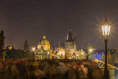 Blurred motion of crowd of people on Charles Bridge in Prague in Royalty Free Stock Image
