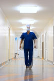 Blurred in motion doctor. In long corridor Stock Images