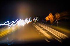 Blurred motion driving at night royalty free stock image