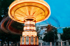 Blurred Motion Effect Of Illuminated Rotating Carousel Merry-Go-Round Stock Photo